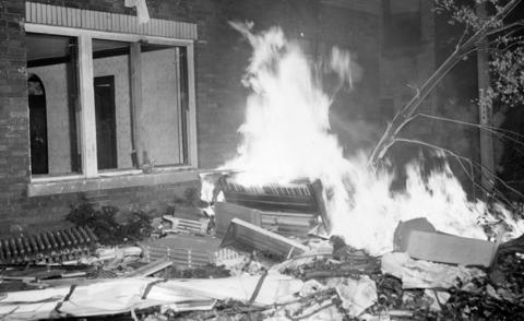 A burning piano sits in front of a building at 6139 W. 19th St., where Cicero residents rioted after learning an African-American family had rented an apartment there in 1951. The rioters threw all of the furniture out of the building and burned most of it.