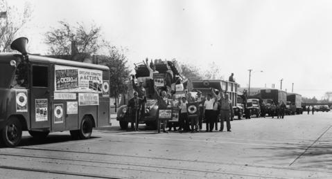 Many residents of Cicero turn out for a town-wide clean-up campaign in 1956. Trucks are lined up and ready to begin collecting trash.