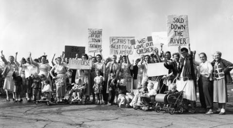 Women protest at 54th Avenue and 37th Street where they say a 38-acre truck terminal was sold illicitly by the town of Cicero in 1957. They claim the school board tried to buy it but was refused.