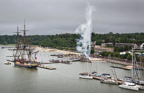 French Tall Ship Hermione arrives in Yorktown to kick off weekend of history along the waterfront on the York River Friday morning. As the French Tall Ship Hermione arrives in Yorktown firework are set off.