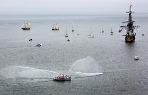 French Tall Ship Hermione arrives in Yorktown to kick off weekend of history along the waterfront on the York River Friday morning. York Co. Fireboat leaders the French Tall Ship Hermione to Yorktown.