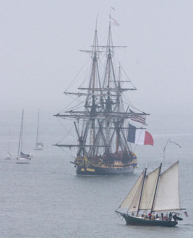 French Tall Ship Hermione arrives in Yorktown to kick off weekend of history along the waterfront on the York River Friday morning. Coming up the York River in the fog.