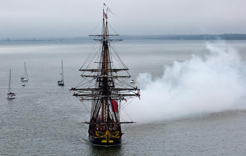 French Tall Ship Hermione arrives in Yorktown to kick off weekend of history along the waterfront on the York River Friday morning.  Canon fire from the French Tall Ship Hermione as they pass Yorktown.