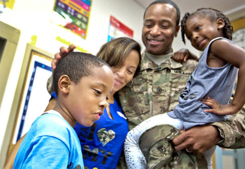 Armstrong School for the Arts, Sgt. Major James Holmes surprises his son inside his class room this morning.  U.S. Army Sgt Major James Holmes has been deployed to Afghanistan for the entire school year.  L to R's Aiden 8 yrs., Dorothy, James and Adrian 4 yrs..