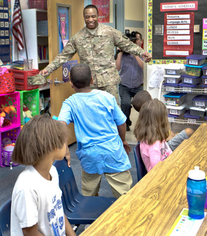 Armstrong School for the Arts, Sgt. Major James Holmes surprises his son inside his class room this morning.  U.S. Army Sgt. Major James Holmes has been deployed to Afghanistan for the entire school year.  Aiden Holmes 8 yrs. sees his father U.S. Army Sgt. Major James Holmes and runs for him. First time Aiden has seen his father since he was deployed to Afghanistan.