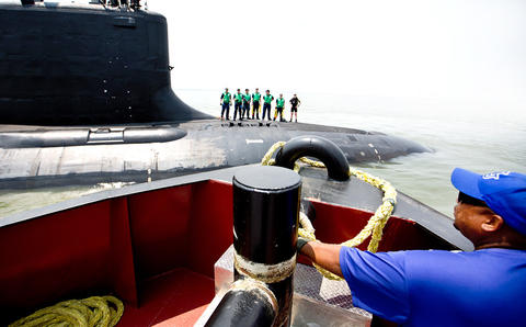 The Virginia-class submarine John Warner completed its final round of sea trials Thursday when it returned to Newport News Shipbuilding, The submarine, which is named for the retired Virginia senator, is scheduled to be commissioned Aug. 1 at Naval Station Norfolk. N.N. Shipbuilding tugboat Capt. Ambrose has a crew member make ready a line for the bow of the new submarine. Virginia-class submarine John Warner docked next to pier #6 at Newport News Shipbuilding.
