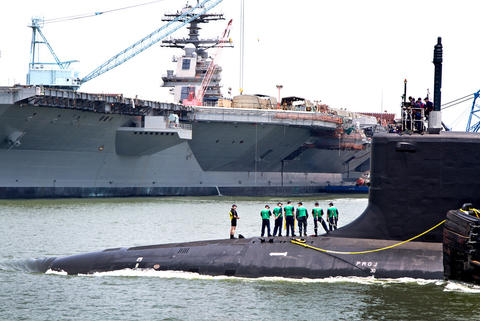 The Virginia-class submarine John Warner completed its final round of sea trials Thursday when it returned to Newport News Shipbuilding, The submarine, which is named for the retired Virginia senator, is scheduled to be commissioned Aug. 1 at Naval Station Norfolk. The submarine John Warner passes the new Aircraft Carrier Ford at Newport News Shipbuilding.