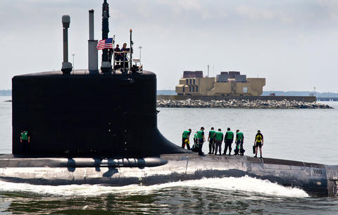 The Virginia-class submarine John Warner completed its final round of sea trials Thursday when it returned to Newport News Shipbuilding, The submarine, which is named for the retired Virginia senator, is scheduled to be commissioned Aug. 1 at Naval Station Norfolk.  The submarine John Warner passes the south Island of the MMBT to enter the James River.