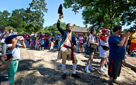 "The reading of the Declaration of Independence begins the ""Revolution in the Streets"" programming daily at 10:30 a.m. at Capitol Building at CW. This is a recreation of the Declaration first being read by then James Madison Williamsburg in 1776. Lt. Col. James Innes as portrayed by Nat Lasley yelling out a cheer for the ""Declaration""."