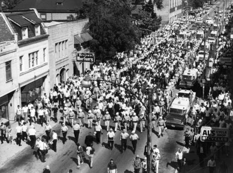 An overhead view of a civil rights march in 1966 in Cicero. About 200 activists are surrounded by county police for protection from nearby hecklers.