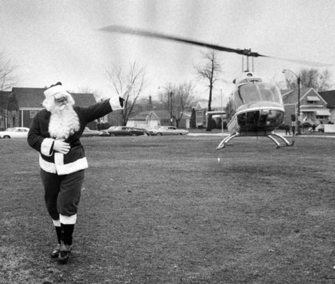 Santa waves to fans after exiting a more modern version of his sleigh -- a helicopter, in 1970 Cicero.