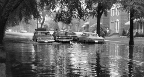 Cars and residents wade through the flooded 3600 block of Austin Boulevard in 1969.