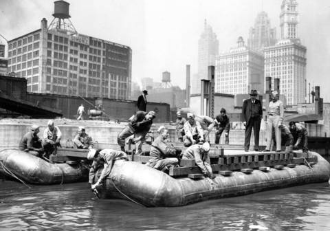 Army engineers build a pontoon bridge across the Chicago River at State Street as a demonstration of their work, circa June 13, 1945. The Tribune Tower is visible in the background.