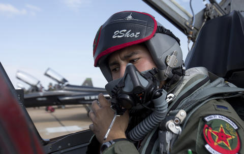 "1st. Lt. Cris ""2 Shot"" Jordan straps on his helmet as he sits inside a a T-38 cockpit preparing for his adversary flight against a Langley F-22. Langley Air Force Base's 71st Fighter Squadron was officially reactivated during a ceremony on Aug. 21, 2015. The 1st will be designated as the 71st Fighter Training Squadron. 17 T-38 aircraft will provide realistic adversary air for the 1st Fighter Wing F-22 training missions."