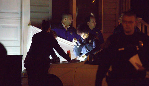 Newport News Police work the scene of a double homicide late Monday evening.