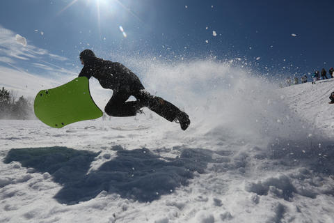 Luke Wilson 14, of Newport News goes airborne after hitting a snow ramp at the bottom of the hill at Riverview Farm Park in Newport News Tuesday afternoon.