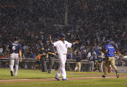 Cubs pitcher Edwin Jackson walks off the field for a rain delay during a game against the Milwaukee Brewers.