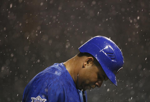 The Cubs' Aramis Ramirez walks off the field after the game was stopped for a rain delay in 2006.