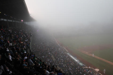 A heavy fog sets in over Wrigley Field as the Cubs play the Cincinnati Reds in 2013.
