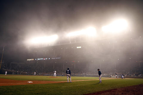 The Cubs play a game against the Atlanta Braves on a foggy evening in 2012.