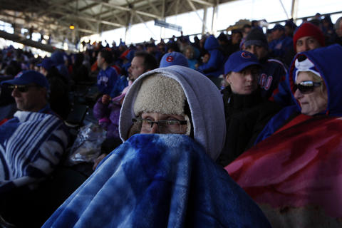 Cubs fan John Boulanger shivers in the shade while his team takes on the Washington Nationals for the season opener in 2012.