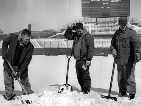 Groundskeepers Ben Bogren, from left, Bud Olson and Damian Sheehan shovel snow from the field a few days before the Cubs' opener in 1965.