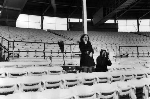 Linda Dillman and Marie Koepeke pretend to cheer on the Cubs, whose home opener was scheduled just days after an 8-inch snowfall at Wrigley Field in 1970.