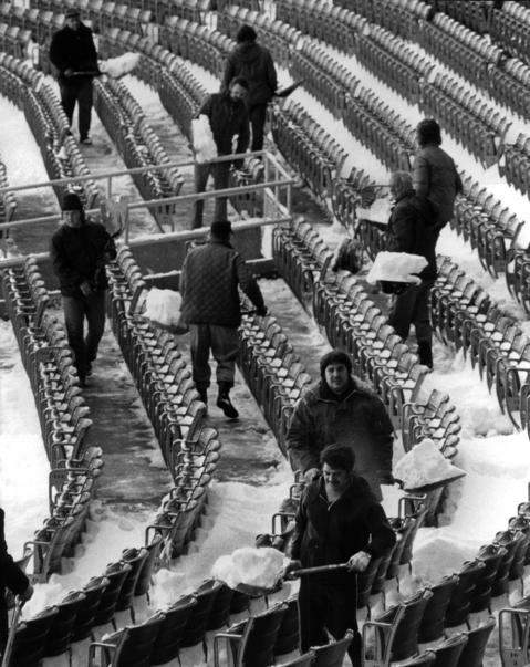 Crews shovel snow in the stands before a Cubs game in 1975.