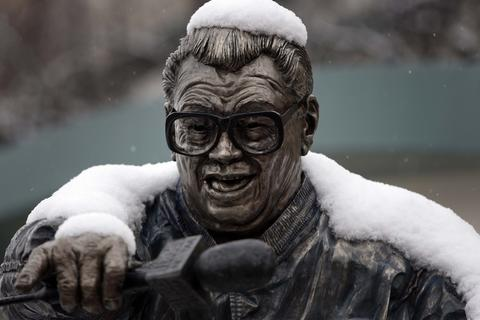 The Harry Caray statue outside Wrigley Field is draped in snow before the Cubs play the New York Mets in 2009.
