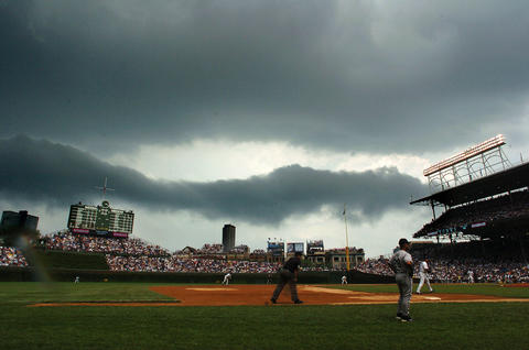 A storm sets in over Wrigley Field before a rain delay in 2004.