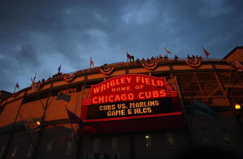 Wrigley Field is seen glowing in the sunset before an evening game in 2003.