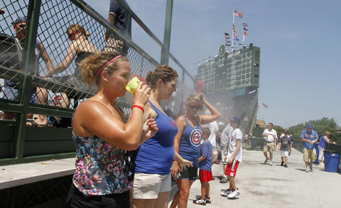 Fans keep cool in the mist as the Cubs host the Philadelphia Phillies in 2011.