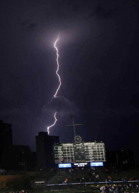 Lightning strikes northeast of Wrigley Field during a Cubs game against San Diego Padres in 2009.