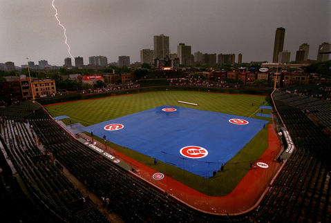 Lightning strikes during a rain delay at a covered Wrigley Field, where the Cubs were to play the White Sox in 1999.