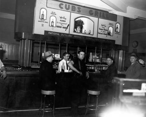 This undated photo shows men at the Cubs Grill at Wrigley Field, which served many varieties of whiskey.