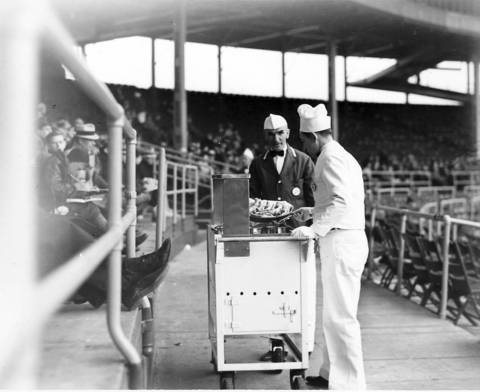 Concession employees sell food from a hot dog wagon at Wrigley Field in May 1938.