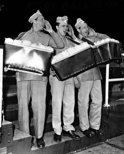 Vendors Albert Kohn, from left, John Studnicki and Ben Kohn sell food items at Wrigley Field on opening day in 1953.