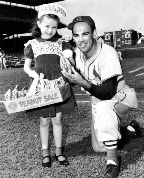 "Mary Mueller sells peanuts to Harry ""Peanuts"" Lowrey, who was formerly a Chicago Cub, at Wrigley Field on Sept. 22, 1954."