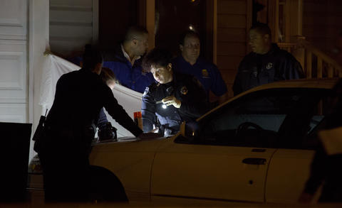 Police investigate the scene of a double homicide that took the life of a 13-year old female and 17-year old male late Monday night, March 8, 2015. Police worked into the early morning hours Tuesday gathering evidence from the scene. The deaths were the 11th and 12th of the year in the city of Newport News.