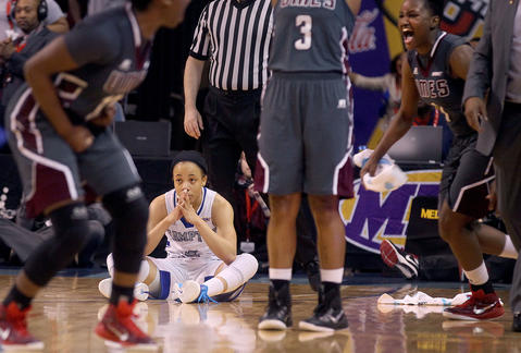 Hampton University's Kenia Cole sits on the court after being screened out a play that allowed Maryland Eastern Shore's Jessica Long to shoot a last second basket giving Maryland the victory 52-50 in the MEAC quarterfinal game Wednesday.