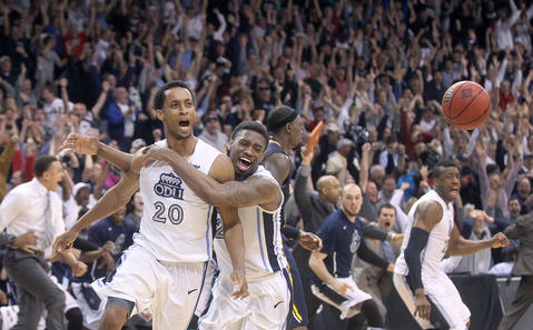 Old Dominion's Trey Freeman and Ambrose Mosley celebrate after Freeman put up a last second three pointer to beat Murray State 72-69 Wednesday in Norfolk.