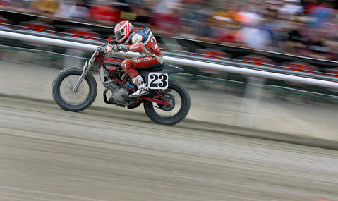 Jeffery Carver heads down the straight away at Colonial Downs Saturday during the Mega Mile flat track motorcycle racing event.