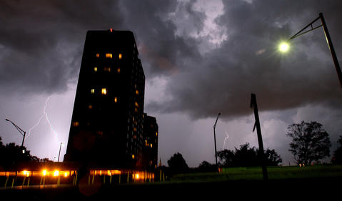 Lightning strikes near the Windward Tower apartment building as a pop-up thunderstorm moves through Newport News Thursday night.