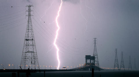 A bolt of lightning strikes the water near the James River Bridge Wednesday evneing as strong thunderstorms move through the area. No Mags, No Sales, No Internet, No TV