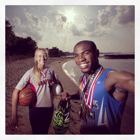 Christa Hall of Grafton is the overall female Daily Press Athlete of the Year is joined by Charles Graham of Phoebus the male Athlete of the Year. They were photographed at Yorktown at the the photo was processed through Instagram using the Valencia filter.