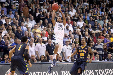 Old Dominion's Trey Freeman puts up a last second three pointer to beat Murray State 72-69 Wednesday advancing to the NIT tournament semifinals in New York.