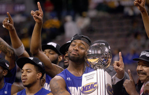 Hampton's Jervon Pressley holds the MEAC Championship trophy after the team downed Delaware State 82-61 Saturday in Norfolk.