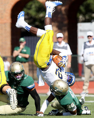 William & Mary's DeAndre Houston-Carson upends Delaware running back Kareem Williams during the second quarter Saturday in Williamsburg.