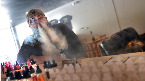 Customer Ryan Daily blows vapor cloud from both nostrils. Besides the flavor, some of the appeal of the product seems to be the many designs one can learn to make with the vapor.