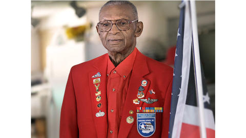 William Tucker poses in his Hampton home wearing his Tidewater chapter of the Tuskegee Airmen jacket. Tucker remembers when the Voting Rights Act passed. He used to put Bobby Scott in his car, drive him around black neighborhoods with a loud speaker, trying to get out the vote. He raised a successful family and wants to encourage young people to stay interested in who governs them and vote in each election.
